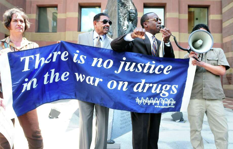 Activists speak at a protest about the War on Drugs in front of CIty Hall in New Haven, Connecticut in 2013. We've been losing this war for awhile — but maybe that's the point. Photo: /