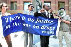 Activists speak at a protest about the War on Drugs in front of CIty Hall in New Haven, Connecticut in 2013. We've been losing this war for awhile — but maybe that's the point.