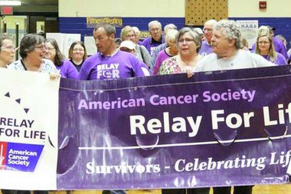 Huron County Relay for Life supporters came together Friday to raise money and awareness for the American Cancer Society. Supporters and survivors joined hands and displayed signs throughout Bad Axe Middle School to beat cancer. For more photos of the event, see Page 8A. (Andrew Mullin/Huron Daily Tribune)