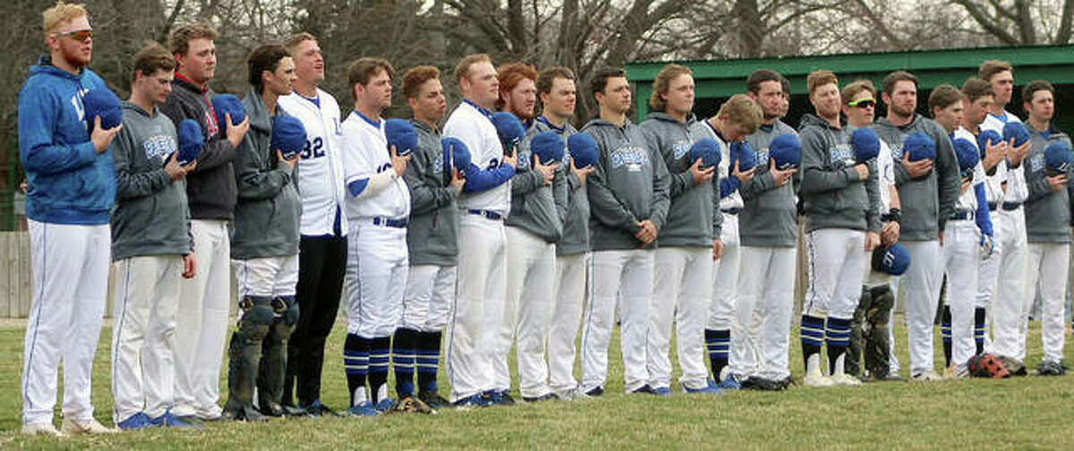 The Lewis and Clark Community College baseball team lines up for the playing of the National Anthem prior to a game against St. Charles Community College this season. LCCC finished the season 30-17, its best record since 1996, when it advanced to the NJCAA World Series.