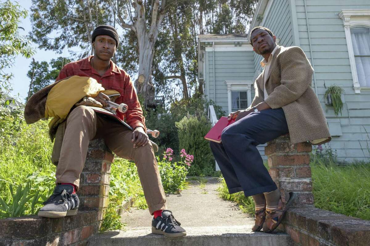 """This image released by A24 shows Jimmie Fails, left, and Jonathan Majors in character from the film, """"The Last Black Man in San Francisco."""" (David Moir/A24 via AP)"""