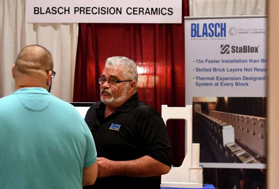 Chris Wilkins, manufacturing manager at Blasch Precision Ceramics, speaks to job seeker during the annual Times Union technology, manufacturing job fair on Monday, May 20, 2019, at the Marriott in Colonie, N.Y. (Will Waldron/Times Union) Photo: Will Waldron / 20046987A