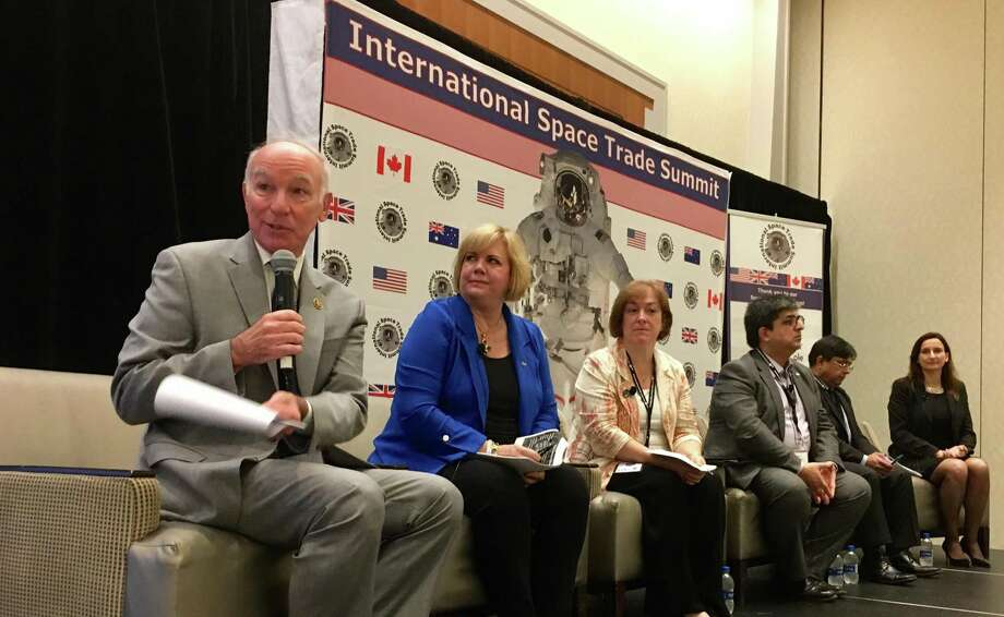 U.S. Rep. Joe Courtney, left, leads a panel of space program officials from NASA, Canada, Great Britain, Australia and New Zealand on Monday at the Hartford Marriott, as part of the first-ever space industries summit organized by the U.S. Department of Commerce Export Assistance Center. Photo: Dan Haar /Hearst Connecticut Media /