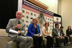 U.S. Rep. Joe Courtney, left, leads a panel of space program officials from NASA, Canada, Great Britain, Australia and New Zealand on Monday at the Hartford Marriott, as part of the first-ever space industries summit organized by the U.S. Department of Commerce Export Assistance Center.