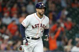 Houston Astros center fielder George Springer (4) heads to first after hitting a home run in the 1st inning of an MLB baseball game at Minute Maid Park Wednesday, May 8, 2019, in Houston.
