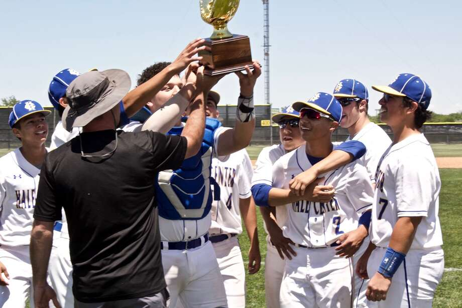 The Hale Center Owls celebrate their regional quarterfinals victory with the team's fourth golden glove in a row. Photo: Don Brown/For The Herald