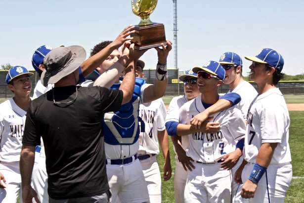 The Hale Center Owls celebrate their regional quarterfinals victory with the team's fourth golden glove in a row.
