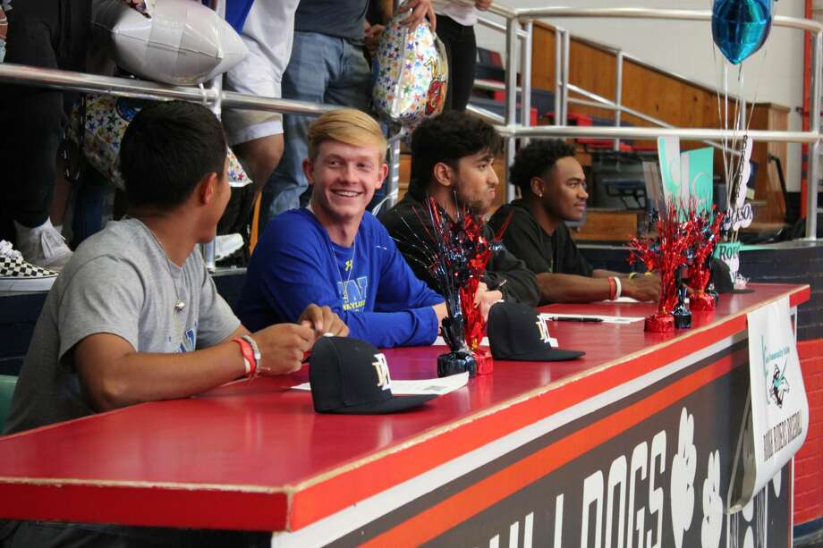 Four Plainview High School athletes sign to play college basketball. Photo: Alex Driggars/For The Herald