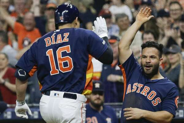 HOUSTON, TEXAS - APRIL 07: Aledmys Diaz #16 of the Houston Astros celebrates with Jose Altuve #27 after hitting a home run in the first inning against the Oakland Athletics at Minute Maid Park on April 07, 2019 in Houston, Texas. (Photo by Bob Levey/Getty Images)