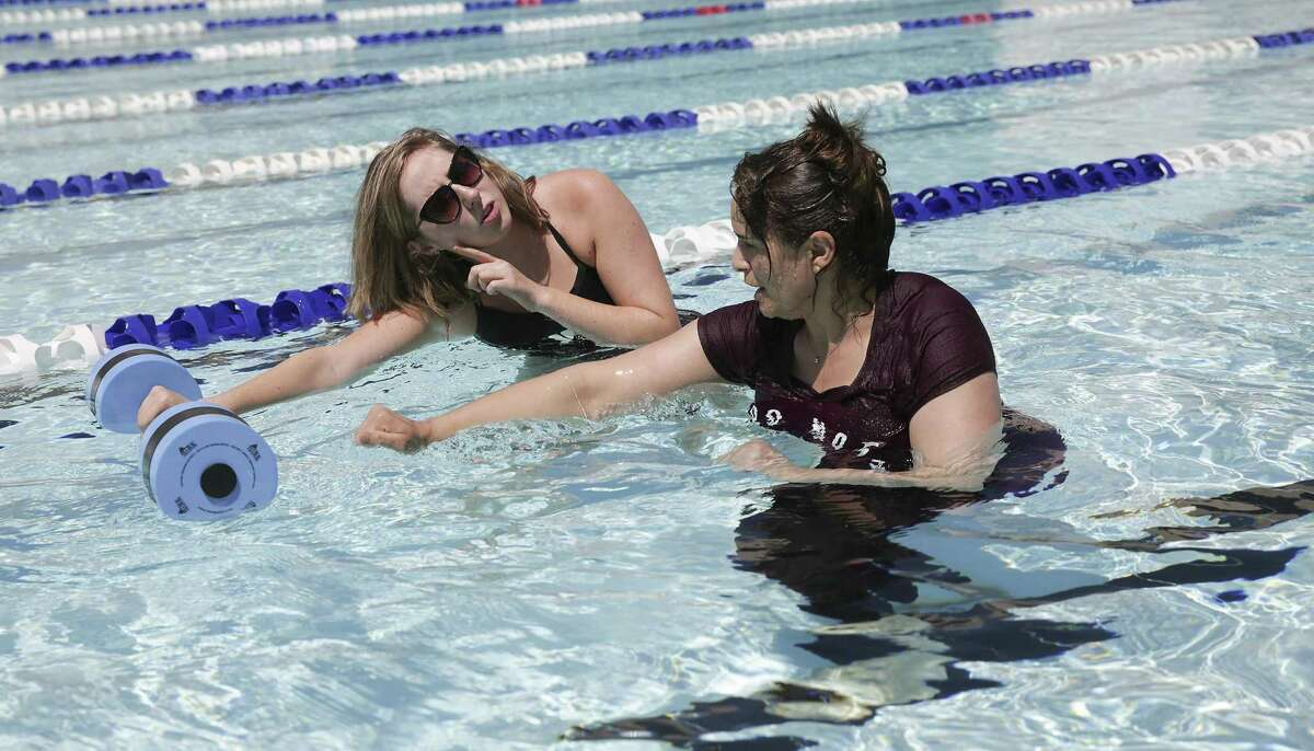 Nidhal Khille , a Muslim refugee, listens to her instructor, Kirby Frank during a swim lesson with other women at Trotter Family YMCA with the assistance of Interfaith Ministries on Monday, April 8, 2019 in Houston.