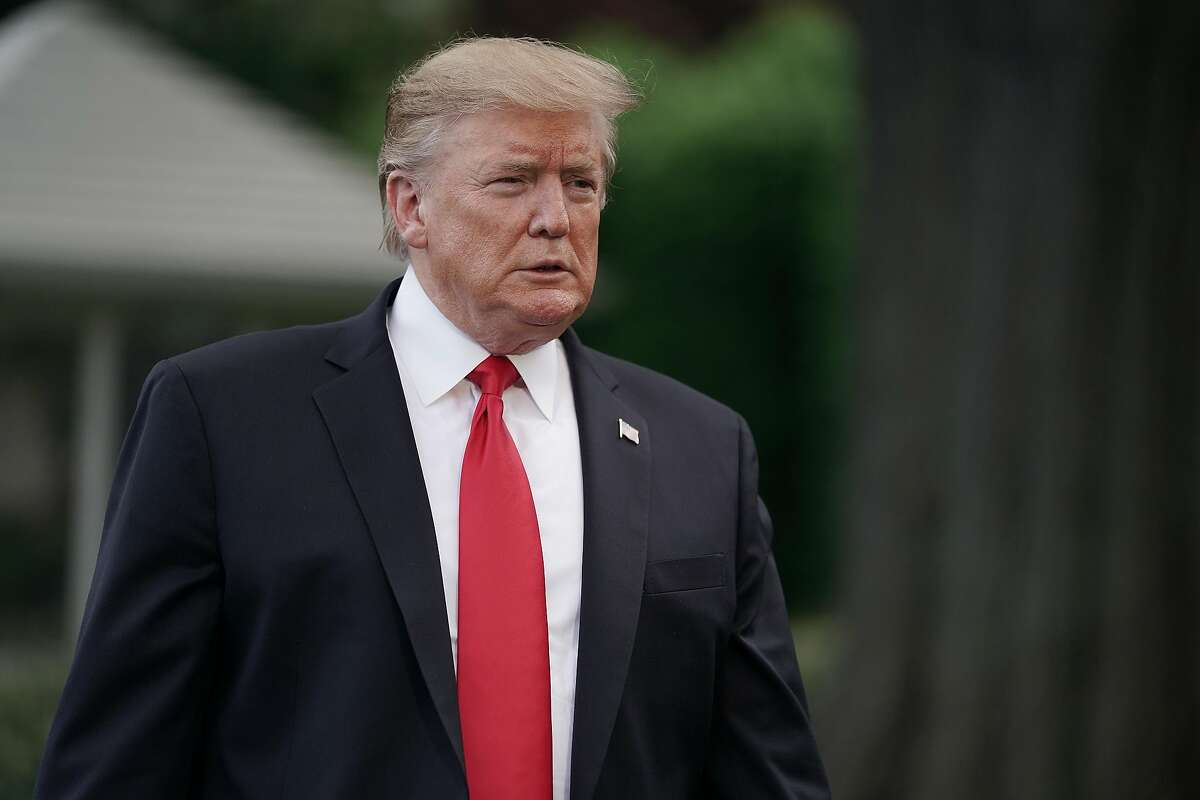 WASHINGTON, DC - MAY 20: U.S. President Donald Trump walks toward journalists as he departs the White House for a campaign rally in Pennsylvania May 20, 2019 in Washington, DC. On his way to Montoursville, Pennsylvania, Trump said that Iran does not currently pose a direct threat to the United States. (Photo by Chip Somodevilla/Getty Images)