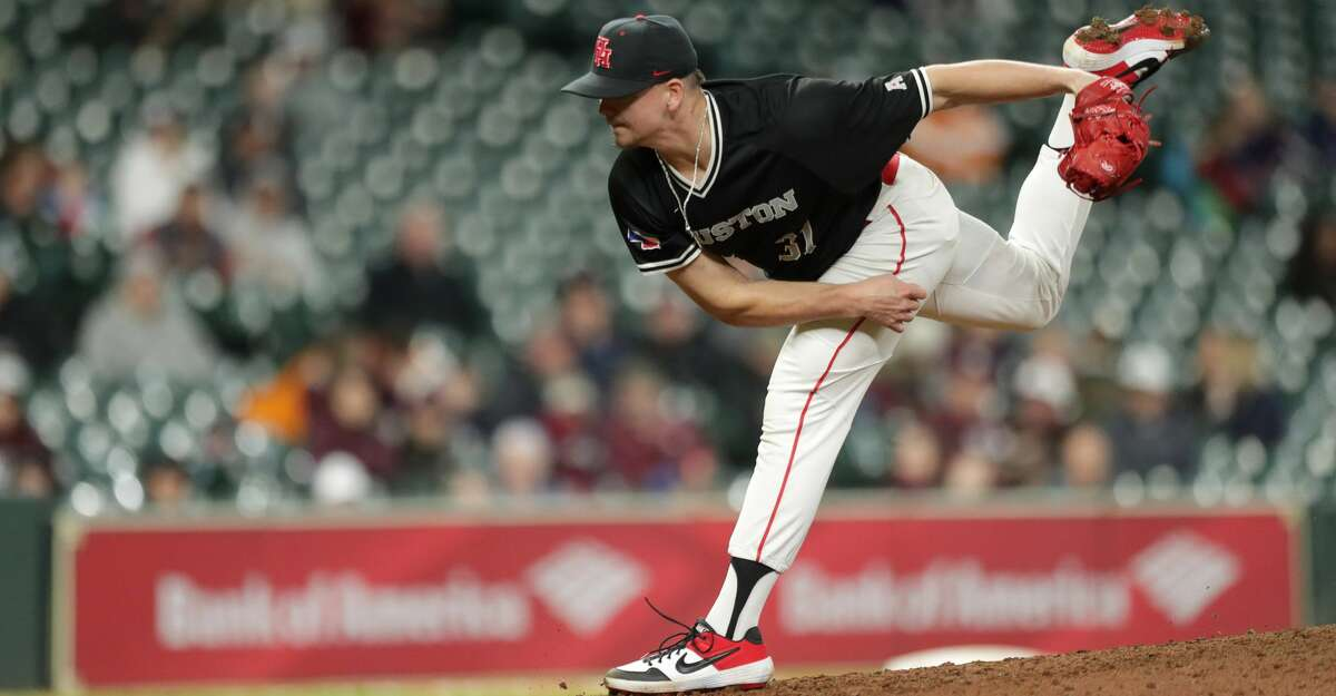 Houston Cougars Devon Roedahl (31) pitches during the sixth inning of a game in the 2019 Shriners College Classic at Minute Maid Park, Sunday, March 3, 2019, in Houston.