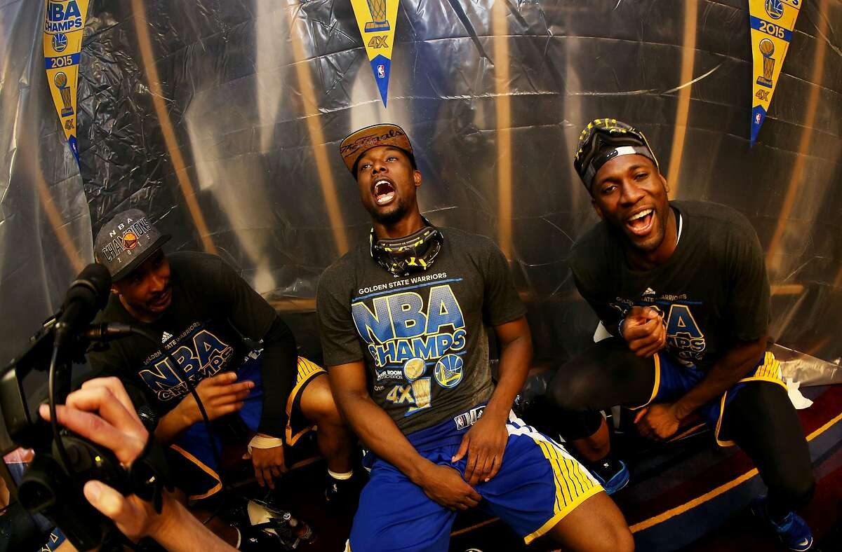 In this file photo, Harrison Barnes #40 of the Golden State Warriors and teammates celebrate in the locker room after they defeated the Cleveland Cavaliers 105 to 97 in Game Six of the 2015 NBA Finals at Quicken Loans Arena on June 16, 2015 in Cleveland, Ohio.