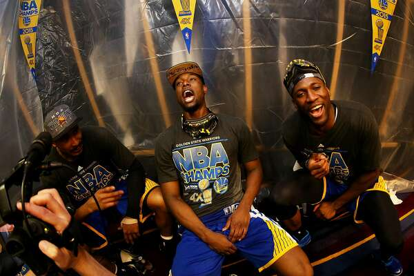 CLEVELAND, OH - JUNE 16: Harrison Barnes #40 of the Golden State Warriors and teammates celebrate in the locker room after they defeated the Cleveland Cavaliers 105 to 97 in Game Six of the 2015 NBA Finals at Quicken Loans Arena on June 16, 2015 in Cleveland, Ohio. NOTE TO USER: User expressly acknowledges and agrees that, by downloading and or using this photograph, user is consenting to the terms and conditions of Getty Images License Agreement. (Photo by Ezra Shaw/Getty Images)