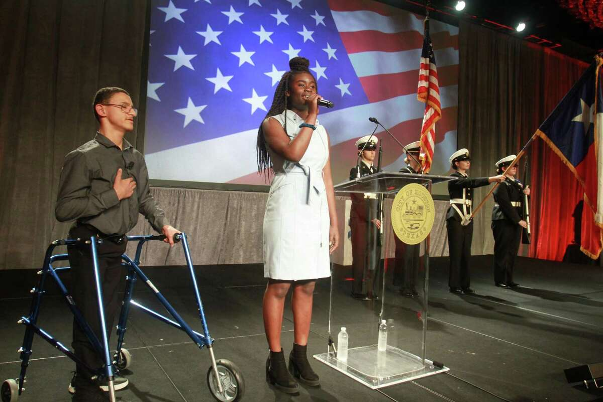 The National Anthem is sung by Olutomilola Akinwanden of Kinder High School for the Performing and Visual Arts at Mayor Sylvester Turner's annual State of the City address on Monday, May 20, 2019. On her left is Jacob Hurst of Theatre Under the Stars River Kids.