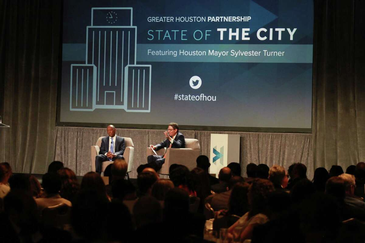 Mayor Sylvester Turner, left, and Scott McClelland, chair, Greater Houston Partnership, and president and CEO of H-E-B, have a discussion during the mayor's annual State of the City address on Monday, May 20, 2019.