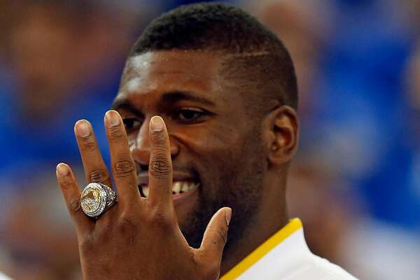 Golden State Warriors' Festus Ezeli shows off his NBA Championship ring after ceremony before playing New Orleans Pelicans during NBA game at Oracle Arena in Oakland, Calif., on Tuesday, October 27, 2015.