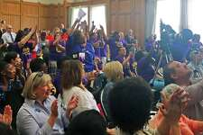 Nursing home workers in the union SEIU Local 1199 New England cheered as they heard that the Lamont administration has endorsed a proposal to increase Medicaid funding that supports their wages on Monday May 20, 2019 at the state Capitol in Hartford, Conn.