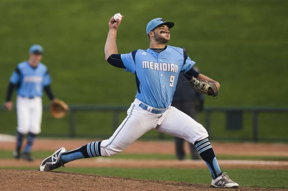 Meridian's Hunter Merillat pitches the ball during a game against St. Charles on Monday, May 20, 2019 at Dow Diamond. (Katy Kildee/kkildee@mdn.net) Photo: (Katy Kildee/kkildee@mdn.net)