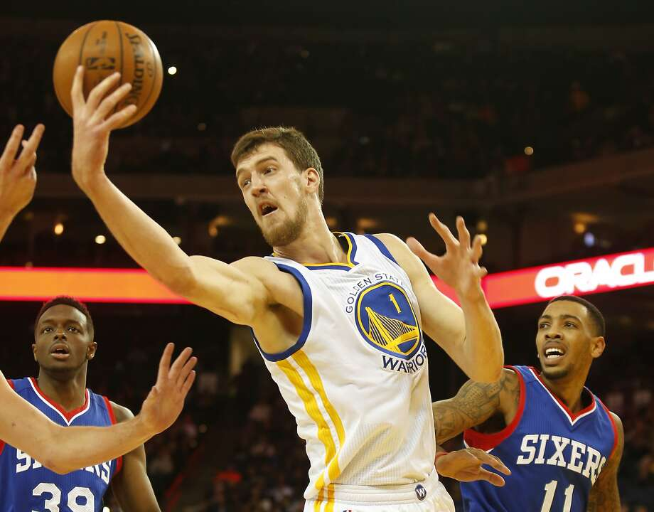 Golden State Warriors center Ognjen Kuzmic reaches for a rebound during the fourth quarter of the basketball game on Tuesday, December 30, 2014 in Oakland, Calif. Photo: Beck Diefenbach, Special To The Chronicle