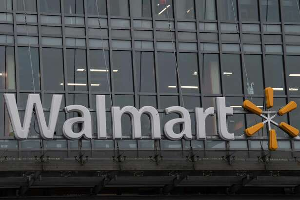 "The Walmart logo is seen on a store in Washington, DC, on March 1, 2019. - Walmart is in damage-control mode over a plan to phase out store greeters, a shift that closes off an employment niche that had frequently been taken by disabled workers. The retail giant, the biggest employer in the United States, has revamped the position of ""People Greeter"" into ""Customer Host"" and added new tasks, such as handling customer refunds, scanning receipts and checking shopping carts. (Photo by NICHOLAS KAMM / AFP) (Photo credit should read NICHOLAS KAMM/AFP/Getty Images)"