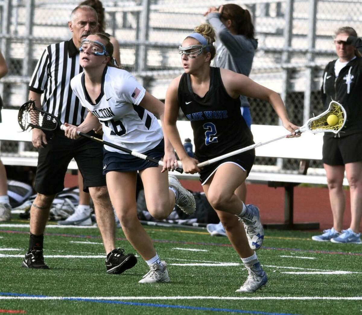 Darien's Ashley Humphrey (2) gets out in front of Wilton's Meghan Lane (16) during the FCIAC girls lacrosse semifinals at Testa Field in Norwalk on Monday, May 20, 2019.