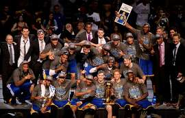 CLEVELAND, OH - JUNE 16:  The Golden State Warriors celebrate with the Larry O'Brien NBA Championship Trophy after winning Game Six of the 2015 NBA Finals against the Cleveland Cavaliers at Quicken Loans Arena on June 16, 2015 in Cleveland, Ohio. NOTE TO USER: User expressly acknowledges and agrees that, by downloading and or using this photograph, user is consenting to the terms and conditions of Getty Images License Agreement.  (Photo by Jason Miller/Getty Images)