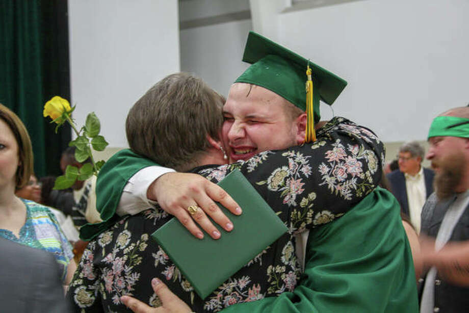 Relief and hugs after graduation at Metro-East Lutheran High School on Saturday. Photo: Andrew Malo | For The Intelligencer
