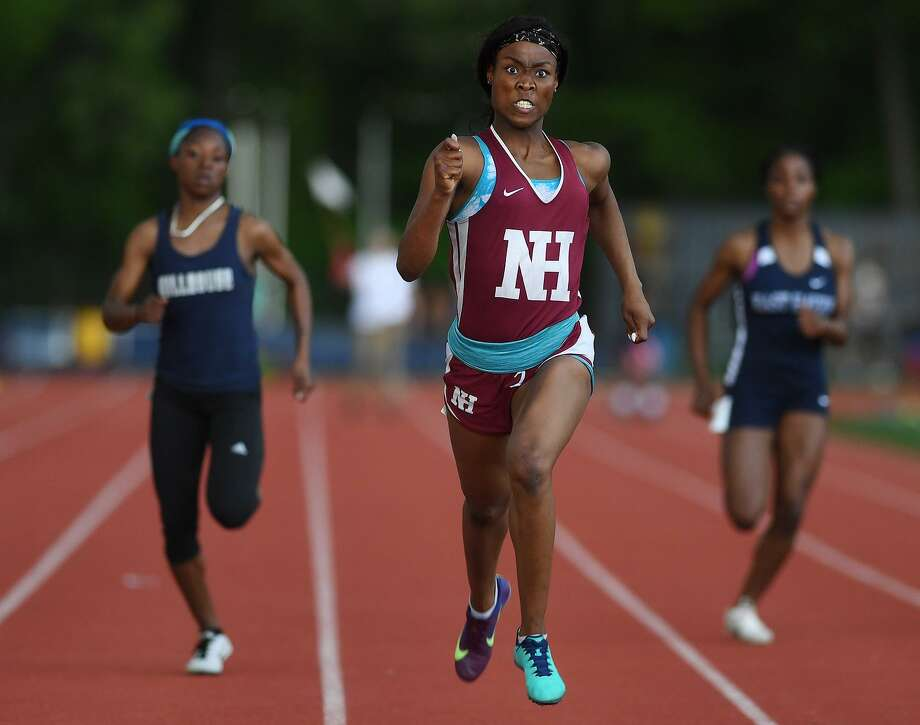 North Haven's Erica Marriott, center, outsprints the competition in the 200 meters at the SCC championships on Monday. Photo: Brian A. Pounds / Hearst Connecticut Media / Connecticut Post