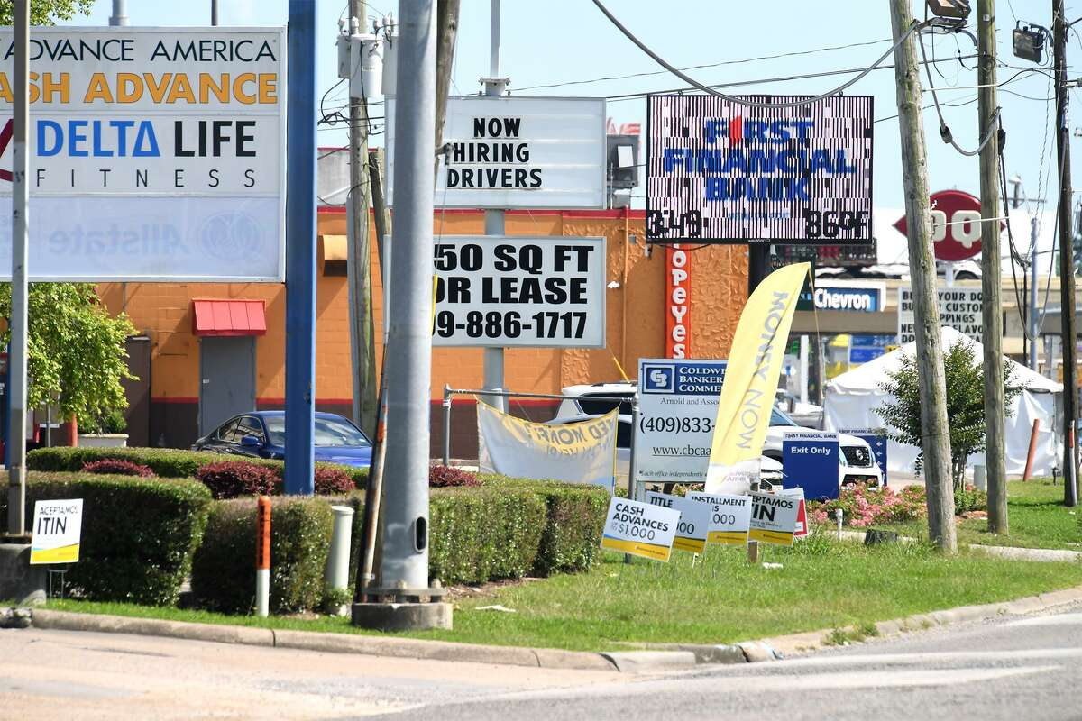 A row of business signs can be seen on FM 105 in Vidor Wednesday. Vidor officials are looking to implement city-wide zoning that is focused on preserving home values and promoting business near Interstate 10. Photo taken Wednesday, 5/15/19