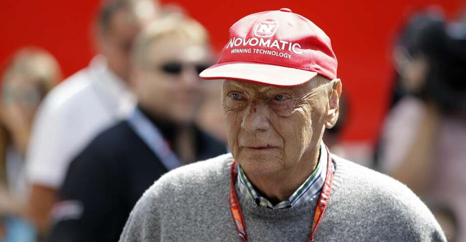 "FILE - In this July 7, 2018, file photo, former Formula One World Champion Niki Lauda of Austria walks in the paddock before the third free practice at the Silverstone racetrack, Silverstone, England. Three-time Formula One world champion Niki Lauda, who won two of his titles after a horrific crash that left him with serious burns and went on to become a prominent figure in the aviation industry, has died. He was 70. The Austria Press Agency reported Lauda's family saying in a statement he ""passed away peacefully"" on Monday, May 20, 2019. (AP Photo/Luca Bruno, File) Photo: Luca Bruno/Associated Press"
