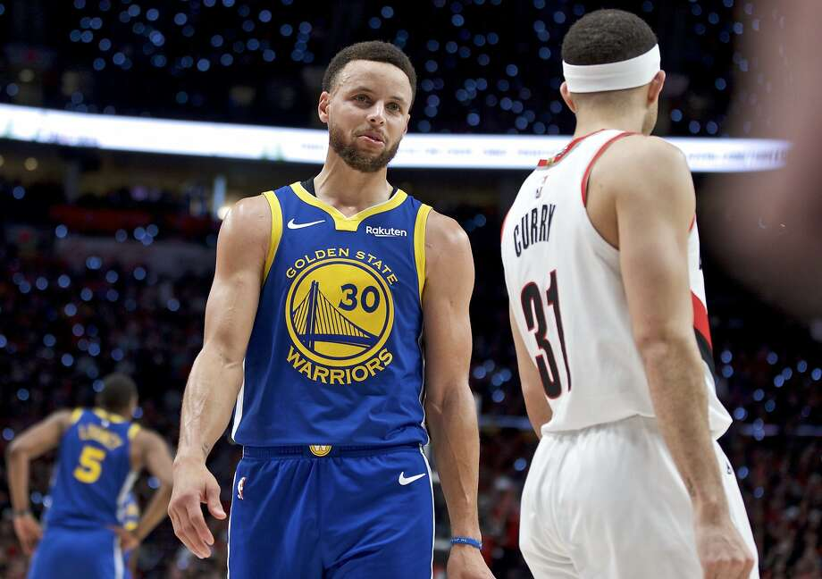 Golden State Warriors guard Stephen Curry, left, talks to Portland Trail Blazers guard Seth Curry during the second half of Game 3 of the NBA basketball playoffs Western Conference finals Saturday, May 18, 2019, in Portland, Ore.  Photo: Craig Mitchelldyer / Associated Press