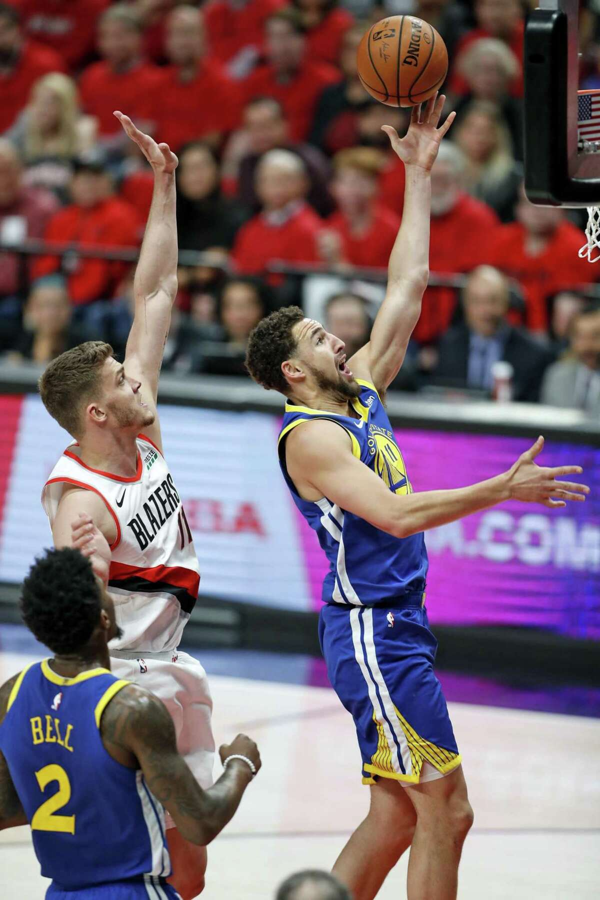 Golden State Warriors' Klay Thompson scores in front of Portland Trail Blazers' Meyers Leonard in 1st quarter during NBA Western Conference Finals' Game 4 at Moda Center in Portland, Oregon on Monday, May 20, 2019.