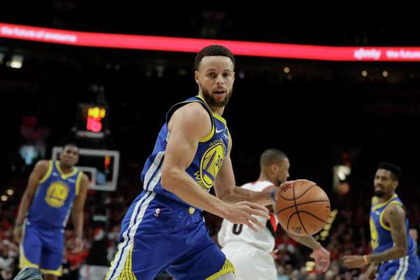 Golden State Warriors guard Stephen Curry (30) dribbles during the first half of Game 4 of the NBA basketball playoffs Western Conference finals against the Portland Trail Blazers, Monday, May 20, 2019, in Portland, Ore.