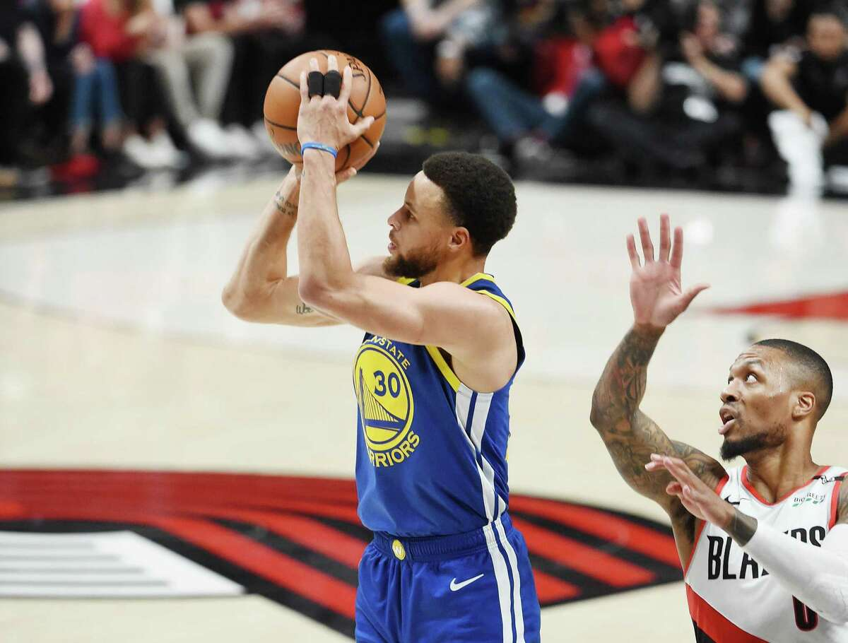 PORTLAND, OREGON - MAY 20: Stephen Curry #30 of the Golden State Warriors shoots the ball against Damian Lillard #0 of the Portland Trail Blazers during the first half in game four of the NBA Western Conference Finals at Moda Center on May 20, 2019 in Portland, Oregon. NOTE TO USER: User expressly acknowledges and agrees that, by downloading and or using this photograph, User is consenting to the terms and conditions of the Getty Images License Agreement. (Photo by Steve Dykes/Getty Images)