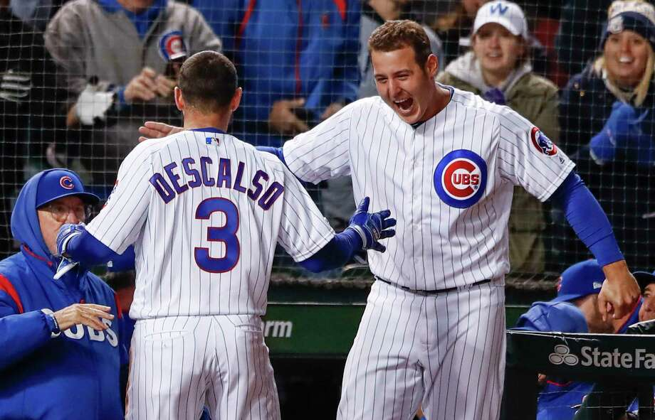 Chicago Cubs' Daniel Descalso, center, celebrates with Anthony Rizzo, right, after hitting three-run triple against the Philadelphia Phillies during the eight inning of a baseball game, Monday, May 20, 2019, in Chicago. (AP Photo/Kamil Krzaczynski) Photo: Kamil Krzaczynski / Copyright 2019 The Associated Press. All rights reserved.