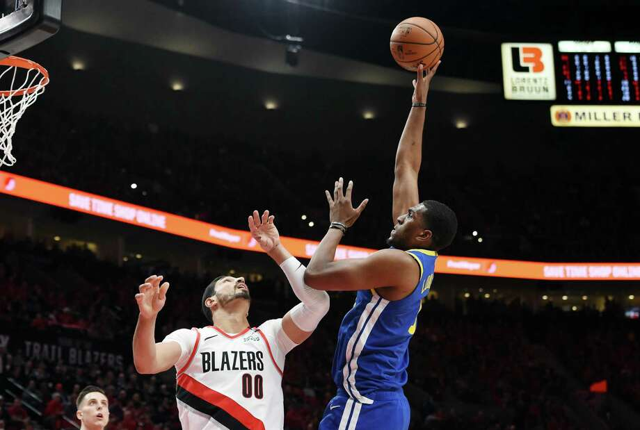 PORTLAND, OREGON - MAY 20: Kevon Looney #5 of the Golden State Warriors shoots the ball against Enes Kanter #00 of the Portland Trail Blazers during the first half in game four of the NBA Western Conference Finals at Moda Center on May 20, 2019 in Portland, Oregon. NOTE TO USER: User expressly acknowledges and agrees that, by downloading and or using this photograph, User is consenting to the terms and conditions of the Getty Images License Agreement. (Photo by Steve Dykes/Getty Images) Photo: Steve Dykes / 2019 Getty Images