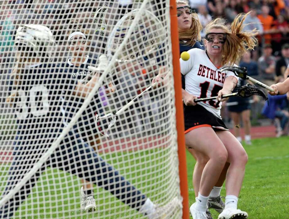 Bethlehem's Paige Halliday (25) scores against Saratoga's goaltender Abigail Searles (30) during a Section II Class A semifinal girls' lacrosse game Monday May 20, 2019, in Delmar, N.Y. (Hans Pennink / Special to the Times Union) Photo: Hans Pennink / Hans Pennink