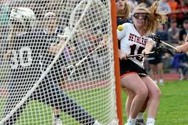 Bethlehem's Paige Halliday (25) scores against Saratoga's goaltender Abigail Searles (30) during a Section II Class A semifinal girls' lacrosse game Monday May 20, 2019, in Delmar, N.Y. (Hans Pennink / Special to the Times Union)