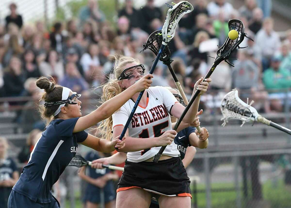 Saratoga's Ashlynn McGrath (9) defends against Bethlehem's Paige Halliday (25) scores against Saratoga's during a Section II Class A semifinal girls' lacrosse game Monday May 20, 2019, in Delmar, N.Y. (Hans Pennink / Special to the Times Union)