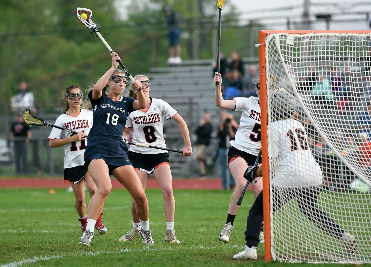 Saratoga's Ella Payer (18) scores against Bethlehem goaltender Sophia Koch (16) during a Section II Class A semifinal girls' lacrosse game Monday May 20, 2019, in Delmar, N.Y. (Hans Pennink / Special to the Times Union)