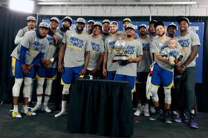 Golden State Warriors pose with trophy after 119-117 overtime win over  Portland Trail Blazers' in NBA Western Conference Finals' Game 4 at Moda Center in Portland, Oregon on Monday, May 20, 2019.