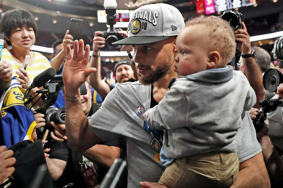 Golden State Warriors' Stephen Curry with son, Canon, after 119-117 overtime win over Portland Trail Blazers' in NBA Western Conference Finals' Game 4 at Moda Center in Portland, Oregon on Monday, May 20, 2019.