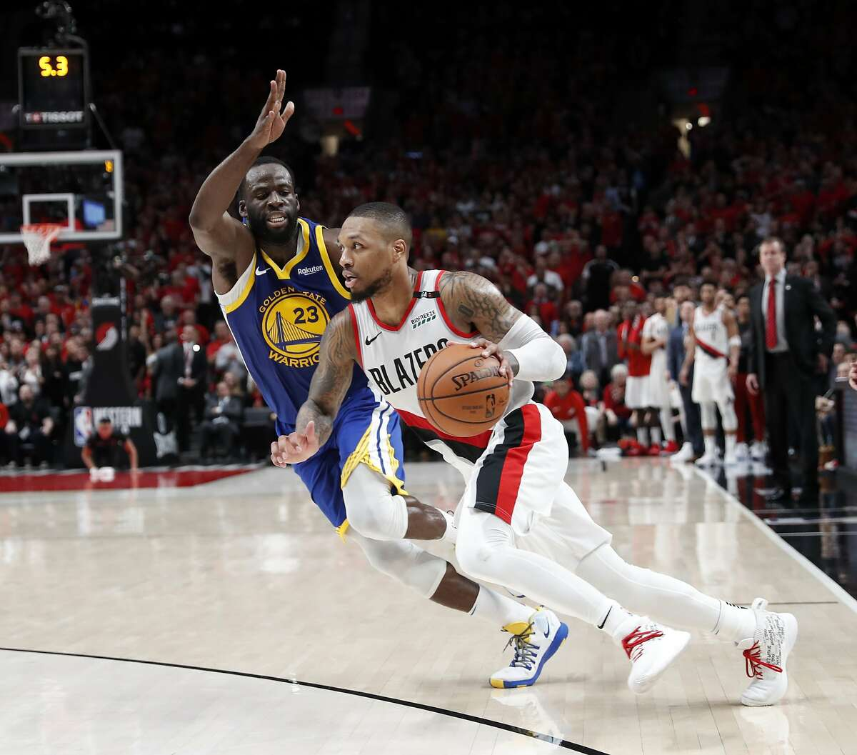 Golden State Warriors' Draymond Green guards Portland Trail Blazers' Damian Lillard in final seconds of Warriors' 119-117 overtime win in NBA Western Conference Finals' Game 4 at Moda Center in Portland, Oregon on Monday, May 20, 2019.