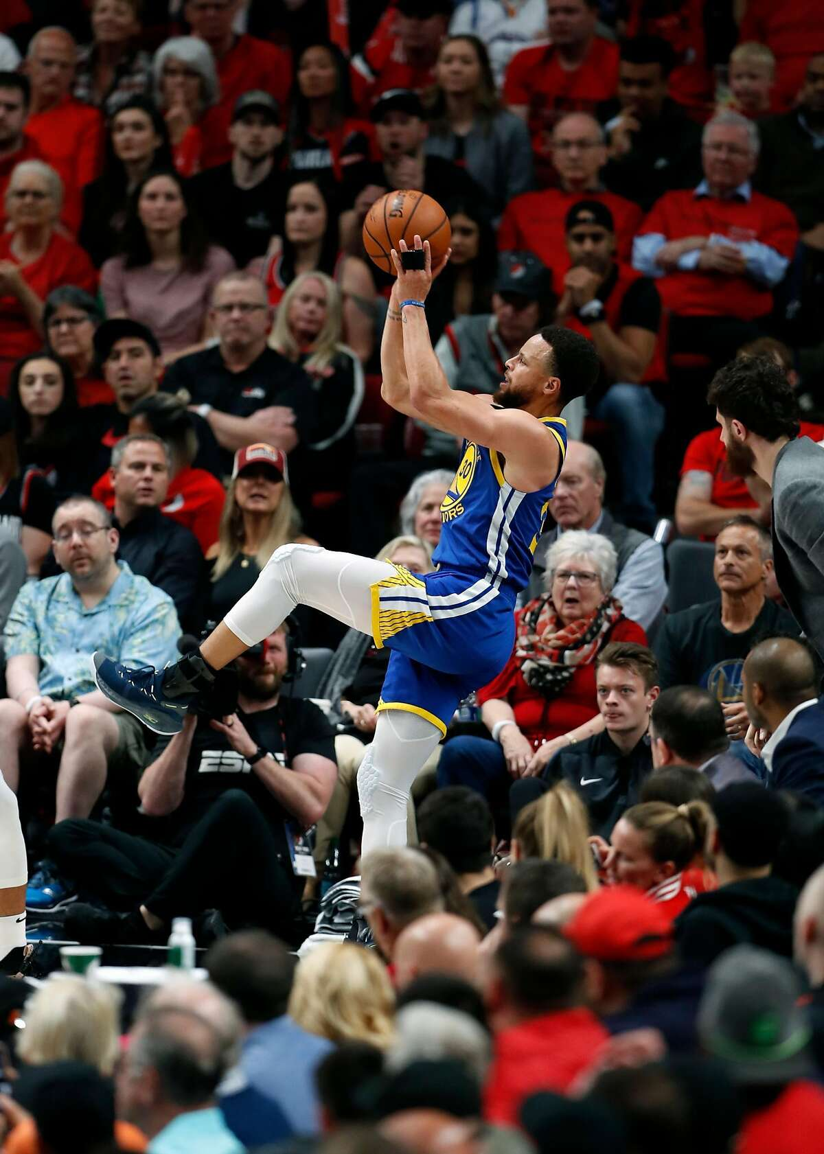 Golden State Warriors' Stephen Curry shoots a 3-pointer in 4th quarter of Warriors' 119-117 overtime win over Portland Trail Blazers in NBA Western Conference Finals' Game 4 at Moda Center in Portland, Oregon on Monday, May 20, 2019.