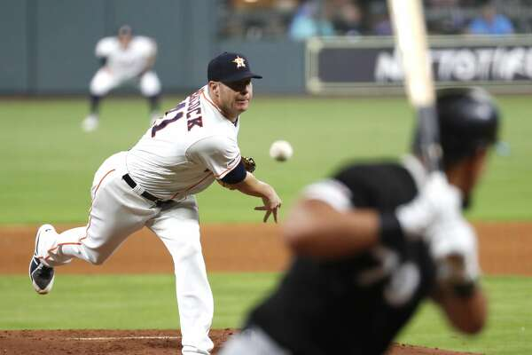 Houston Astros pitcher Brad Peacock (41) pitches to Chicago White Sox hitter Jose Abreu (79) during the fourth inning of a major league baseball game at Minute Maid Park on Monday, May 20, 2019, in Houston.