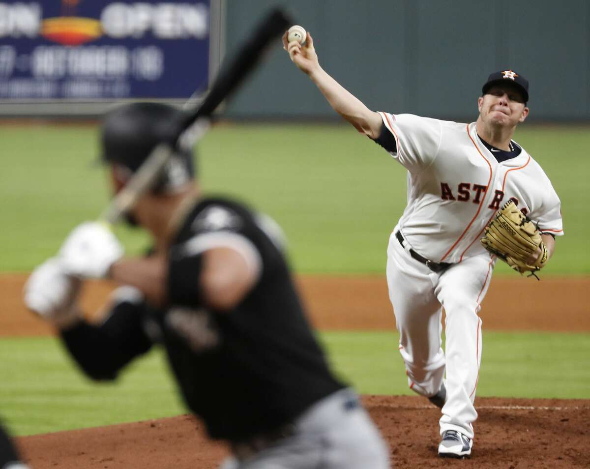 Houston Astros pitcher Brad Peacock (41) pitches to Chicago White Sox hitter Yoan Moncada (10) during the fourth inning of a major league baseball game at Minute Maid Park on Monday, May 20, 2019, in Houston.