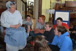 Barbara Suelter tells eighth-grade students from Greenfield Community Schools about the history of Woodlawn Farm on Monday as the students toured sites with links to the Underground Railroad.