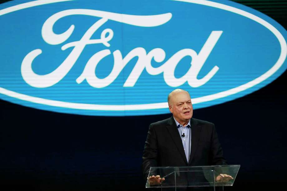 FILE - In this Jan. 14, 2018, file photo Ford President and CEO Jim Hackett prepares to address the media at the North American International Auto Show in Detroit. Ford is cutting about 7,000 white-collar jobs, which would make up 10% of its global workforce. The company has said it was undertaking a major restructuring, and on Monday, May 20, 2019, said that it will have trimmed thousands of jobs by August. In a memo to employees, Monday, Hackett said the fourth wave of the restructuring will start on Tuesday, May 21 with the majority of cuts being finished by May 24. (AP Photo/Carlos Osorio, File) Photo: Carlos Osorio / Copyright 2018 The Associated Press. All rights reserved.