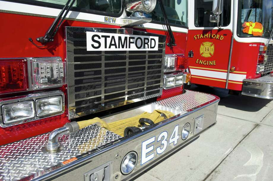 A large magnet indicates that Glenbrook's engine 34 is currently serving as Stamford Fire Rescue engine 5 at Woodside on Wednesday, April 3, 2013. Photo: Lindsay Perry / Lindsay Perry / Stamford Advocate